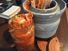 In Ferment ceramic jar with kimchi